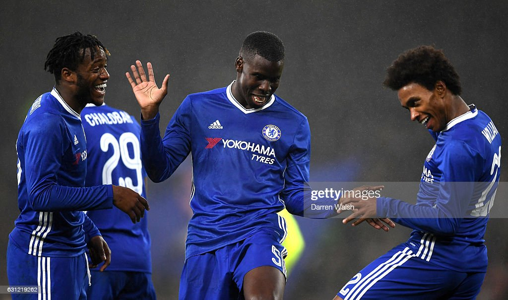 Willian of Chelsea (R) celebrates scoring his sides third goal with Kurt Zouma of Chelsea (C) and Michy Batshuayi of Chelsea (L) during The Emirates FA Cup Third Round match between Chelsea and Peterborough United at Stamford Bridge on January 8, 2017 in London, England.
