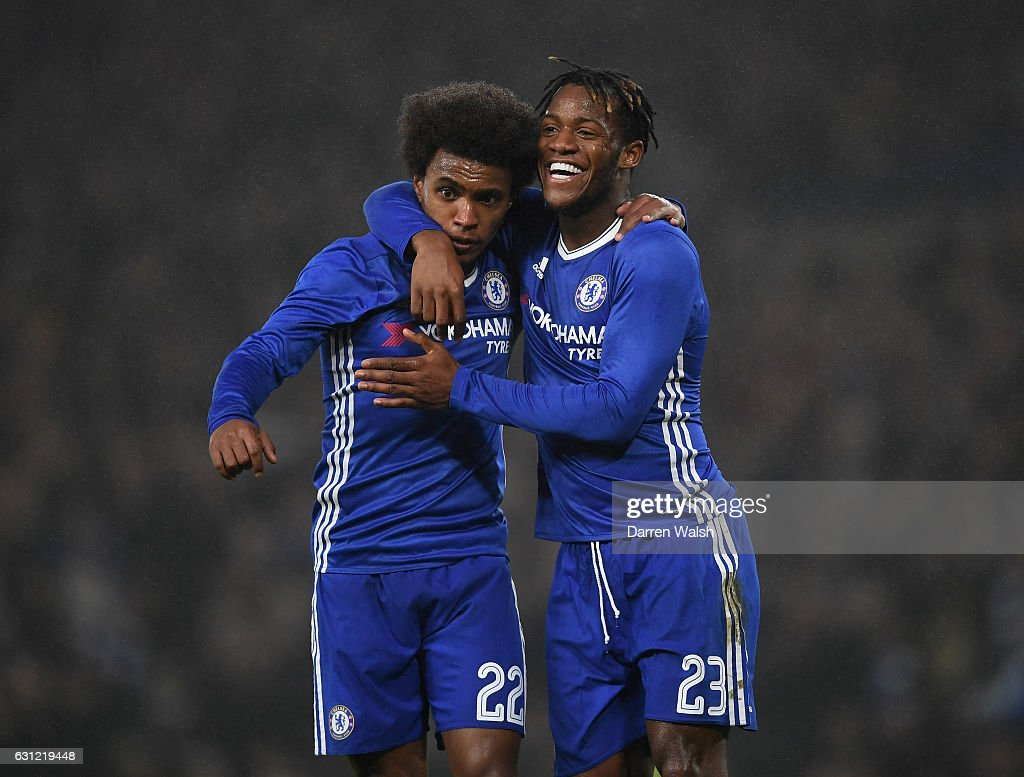 Willian of Chelsea (L) celebrates scoring his sides third goal with Michy Batshuayi of Chelsea (R) during The Emirates FA Cup Third Round match between Chelsea and Peterborough United at Stamford Bridge on January 8, 2017 in London, England.