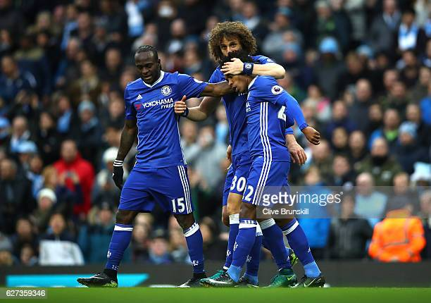 Willian of Chelsea celebrates scoring his team's second goal with his team mates Victor Moses and Diego Costa during the Premier League match between...