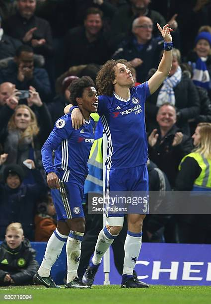 Willian of Chelsea celebrates scoring his team's second goal with his team mate David Luiz during the Premier League match between Chelsea and Stoke...