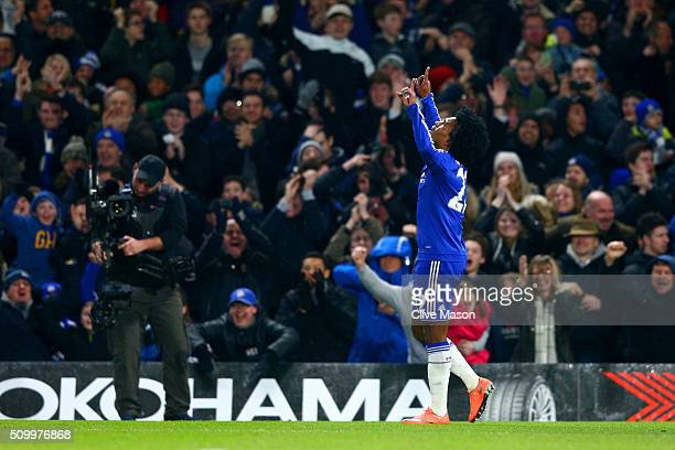 Willian of Chelsea celebrates scoring his team's third goal during the Barclays Premier League match between Chelsea and Newcastle United at Stamford...