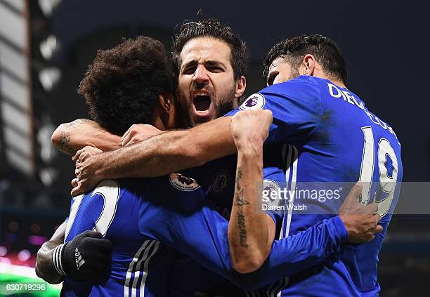Willian of Chelsea celebrates scoring his team's third goal with his team mates Cesc Fabregas and Diego Costa during the Premier League match between...