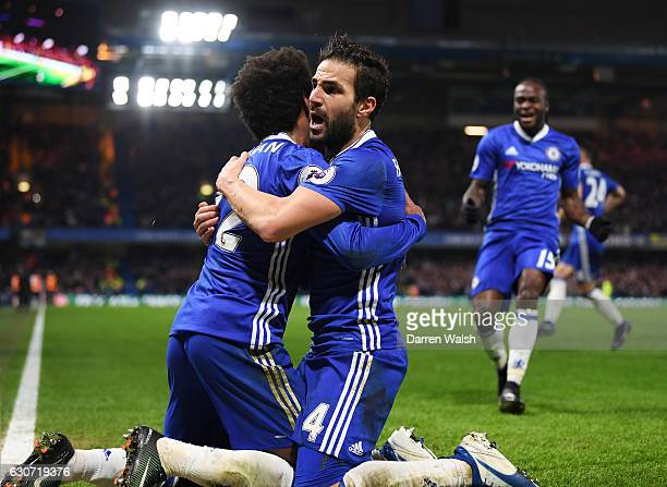 Willian of Chelsea celebrates scoring his team's third goal with his team mate Cesc Fabregas during the Premier League match between Chelsea and...