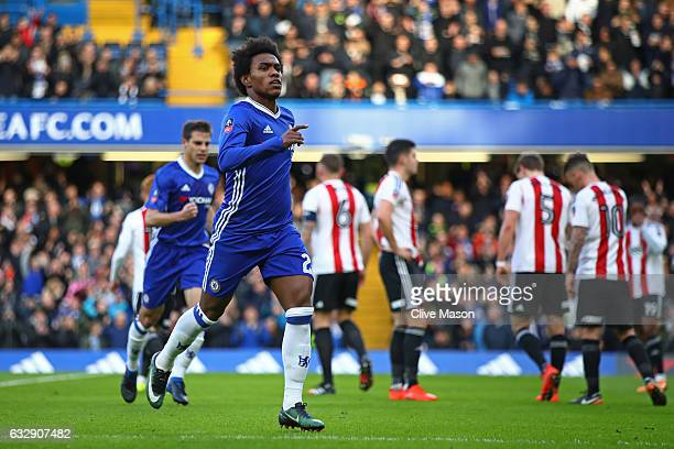 Willian of Chelsea celebrates scoring the opening goal during the Emirates FA Cup Fourth Round match between Chelsea and Brentford at Stamford Bridge...