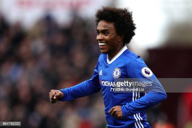 Willian of Chelsea celebrates scoring the opening goal during the Premier League match between Stoke City and Chelsea at Bet365 Stadium on March 18...