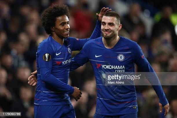 Willian of Chelsea celebrates scoring their 2nd goal with Mateo Kovacic during the UEFA Europa League Round of 16 First Leg match between Chelsea and...