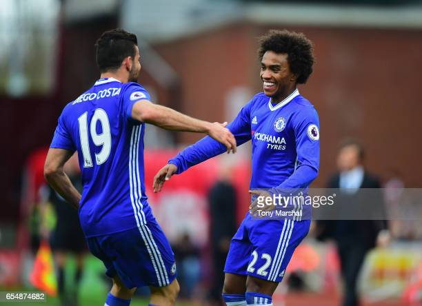 Willian of Chelsea celebrates scoring their first goal with diego Costa of Chelsea during the Premier League match between Stoke City and Chelsea at...