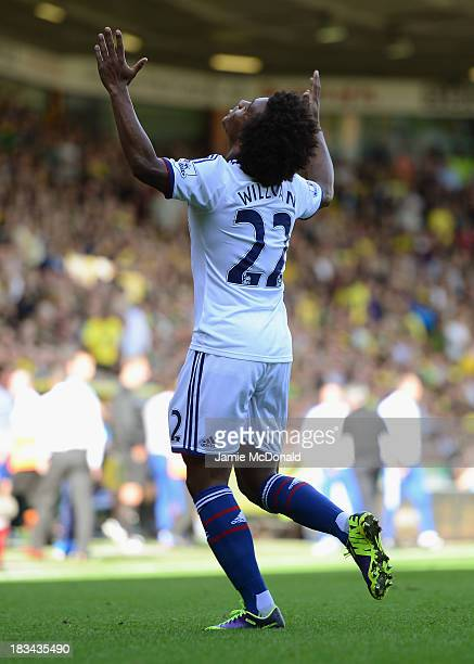 Willian of Chelsea celebrates scoring their third goal during the Barclays Premier League match between Norwich City and Chelsea at Carrow Road on...