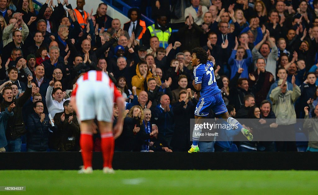Willian of Chelsea celebrates scoring their third goal during the Barclays Premier League match between Chelsea and Stoke City at Stamford Bridge on April 5, 2014 in London, England.