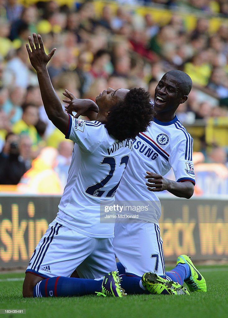 Willian of Chelsea celebrates scoring their third goal with Ramires of Chelsea during the Barclays Premier League match between Norwich City and Chelsea at Carrow Road on October 6, 2013 in Norwich, England.