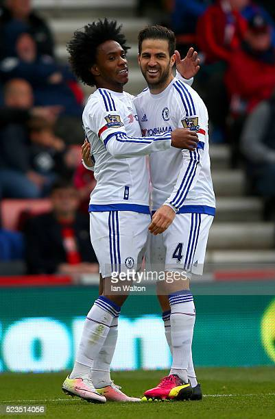 Willian of Chelsea celebrates with Cesc Fabregas of Chelsea after scoring his sides third goal during the Barclays Premier League match between AFC...