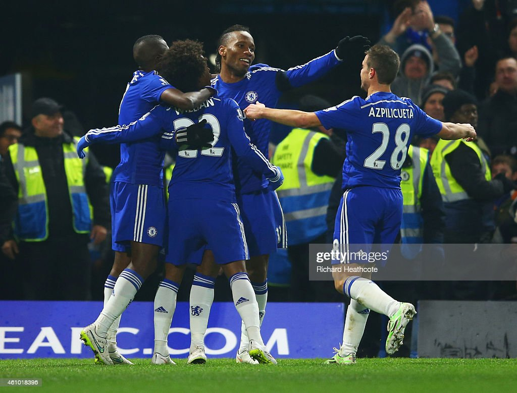Willian of Chelsea (22) celebrates with Ramires (L), Didier Drogba (2R) and Cesar Azpilicueta (R) as he scores their first goal during the FA Cup Third Round match between Chelsea and Watford at Stamford Bridge on January 4, 2015 in London, England.
