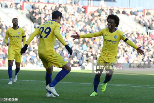 Willian of Chelsea celebrates with team mate Alvaro Morata after scoring his team's third goal during the Premier League match between Burnley FC and...