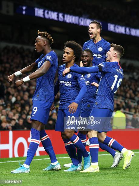 Willian of Chelsea celebrates with team mates after his first goal during the Premier League match between Tottenham Hotspur and Chelsea FC at...