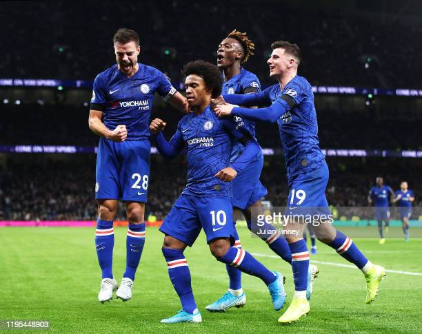 Willian of Chelsea celebrates with team mates after his second goal during the Premier League match between Tottenham Hotspur and Chelsea FC at...