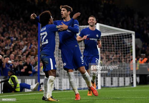 Willian of Chelsea celebrates with team mates after scoring his sides second goal during the Carabao Cup Fourth Round match between Chelsea and...