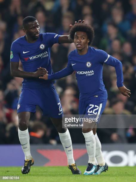 Willian of Chelsea celebrates with teammate Antonio Rudiger after scoring his sides first goal during the Carabao Cup QuarterFinal match between...