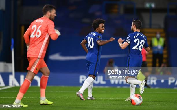 Willian of Chelsea celebrates with teammate Cesar Azpilicueta after scoring his team's second goal during the Premier League match between Chelsea FC...