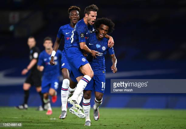 Willian of Chelsea celebrates with teammates after scoring his sides second goal during the Premier League match between Chelsea FC and Manchester...