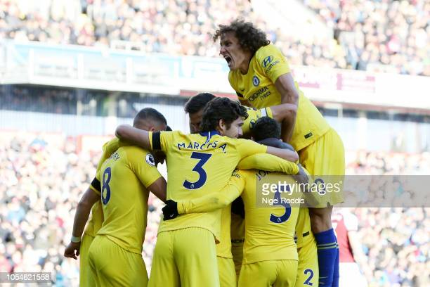 Willian of Chelsea celebrates with teammates after scoring his team's third goal during the Premier League match between Burnley FC and Chelsea FC at...