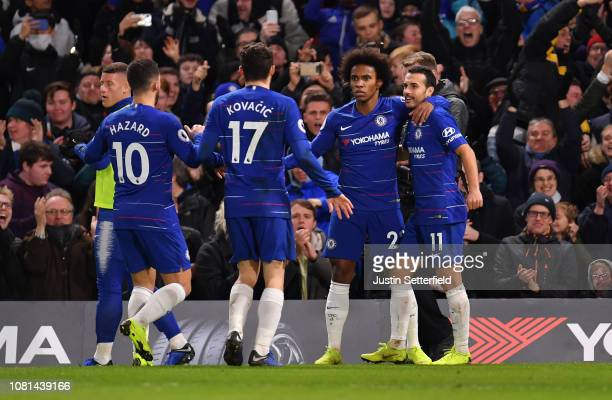 Willian of Chelsea celebrates with teammates after scoring his team's second goal during the Premier League match between Chelsea FC and Newcastle...
