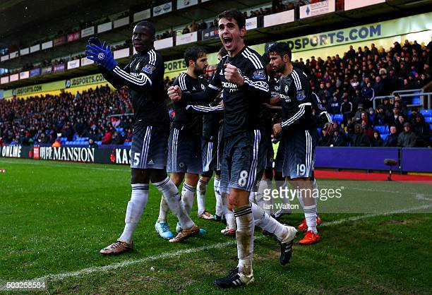 Willian of Chelsea celebrates with teammates after scoring his team's second goal during the Barclays Premier League match between Crystal Palace and...