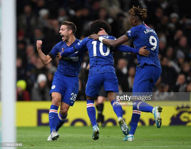 Willian of Chelsea celebrates with teammates Cesar Azpilicueta and Tammy Abraham of Chelsea after scoring his team's second goal from the penalty...