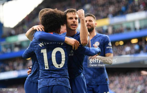 Willian of Chelsea celebrates with teammates Cesar Azpilicueta Ross Barkley and Olivier Giroud after scoring his team's third goal during the Premier...