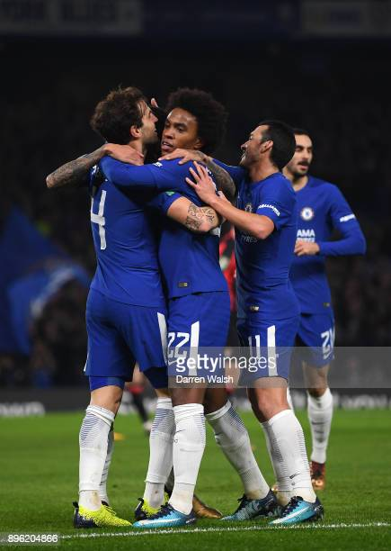 Willian of Chelsea celebrates with teammates Cesc Fabregas and Pedro after scoring his sides first goal during the Carabao Cup QuarterFinal match...