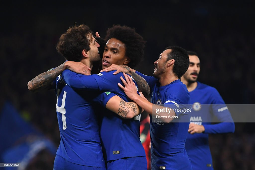 Willian of Chelsea celebrates with teammates Cesc Fabregas and Pedro after scoring his sides first goal during the Carabao Cup Quarter-Final match between Chelsea and AFC Bournemouth at Stamford Bridge on December 20, 2017 in London, England.