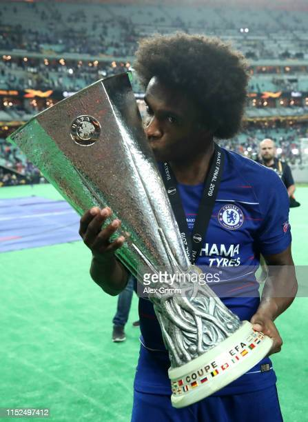 Willian of Chelsea celebrates with the Europa League Trophy following his team's victory in the UEFA Europa League Final between Chelsea and Arsenal...