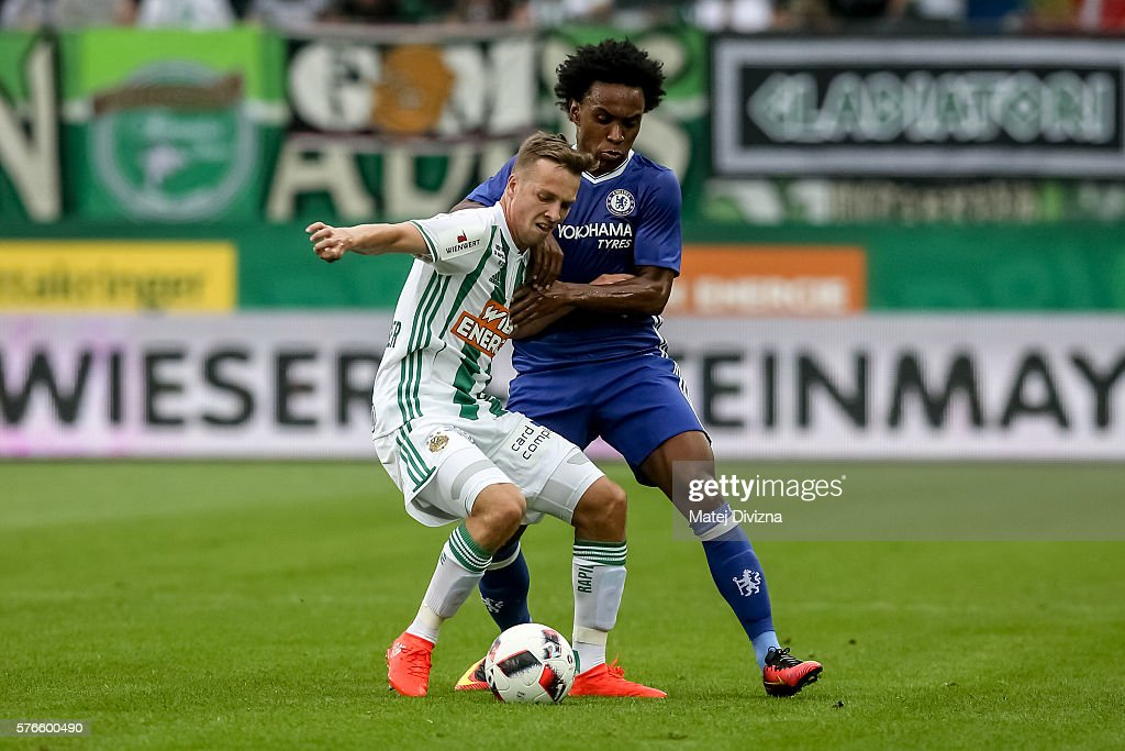 Willian (R) of Chelsea competes for the ball with Philipp Schobesberger (L) of Rapid Vienna during an friendly match between SK Rapid Vienna and Chelsea F.C. at Allianz Stadion on July 16, 2016 in Vienna, Austria.