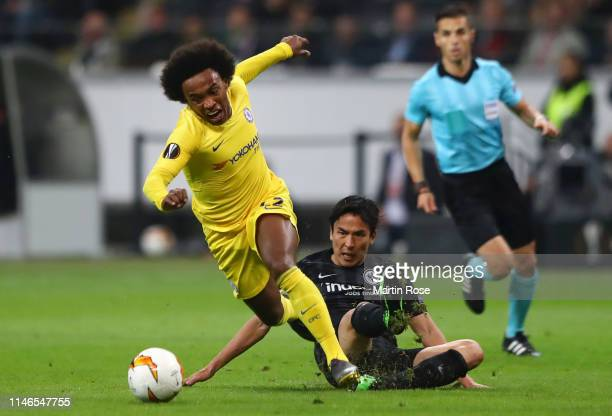 Willian of Chelsea evades Makoto Hasebe of Eintracht Frankfurt during the UEFA Europa League Semi Final First Leg match between Eintracht Frankfurt...