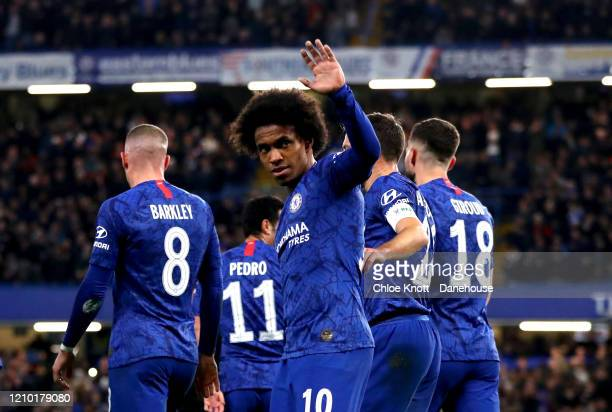 Willian of Chelsea FC celebrates scoring his teams first goal during the FA Cup Fifth Round match between Chelsea FC and Liverpool FC at Stamford...
