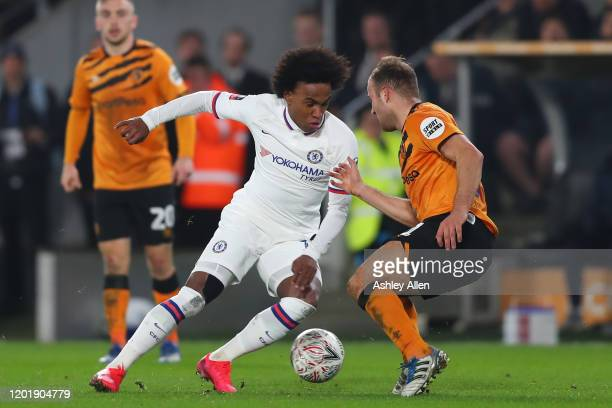 Willian of Chelsea FC gets past Herbie Kane of Hull City during the FA Cup Fourth Round match between Hull City and Chelsea at KCOM Stadium on...