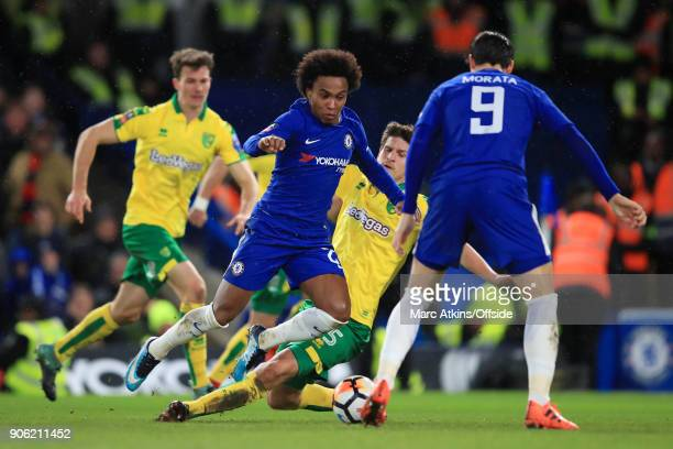 Willian of Chelsea goes down under a challenge from Timm Klose of Norwich during The Emirates FA Cup Third Round Replay match between Chelsea and...