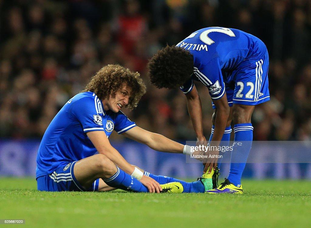 Willian of Chelsea helps David Luiz of Chelsea