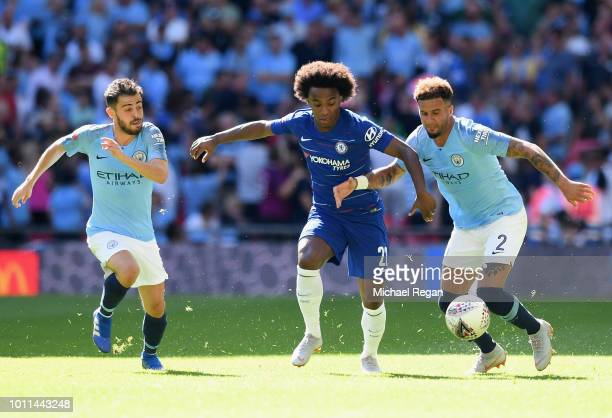 Willian of Chelsea holds off Kyle Walker of Manchester City during the FA Community Shield between Manchester City and Chelsea at Wembley Stadium on...