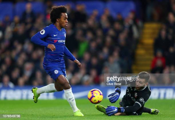 Willian of Chelsea in action against Angus Gunn of Southampton during the Premier League match between Chelsea FC and Southampton FC at Stamford...