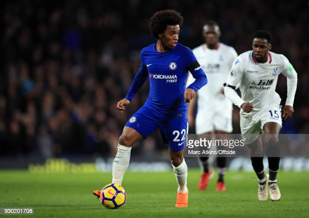 Willian of Chelsea in action with Jeffrey Schlupp of Crystal Palace during the Premier League match between Chelsea and Crystal Palace at Stamford...