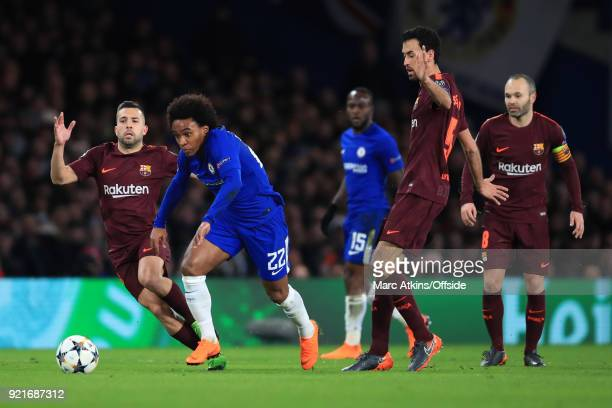 Willian of Chelsea in action with Jordi Alba Sergio Busquets and Andres Iniesta of FC Barcelona during the UEFA Champions League Round of 16 First...