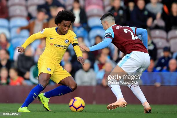 Willian of Chelsea in action with Matthew Lowton of Burnley during the Premier League match between Burnley FC and Chelsea FC at Turf Moor on October...