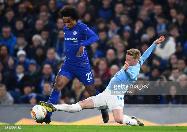 Willian of Chelsea is challenged by Anders Christiansen of Malmo during the UEFA Europa League Round of 32 Second Leg match between Chelsea and Malmo...