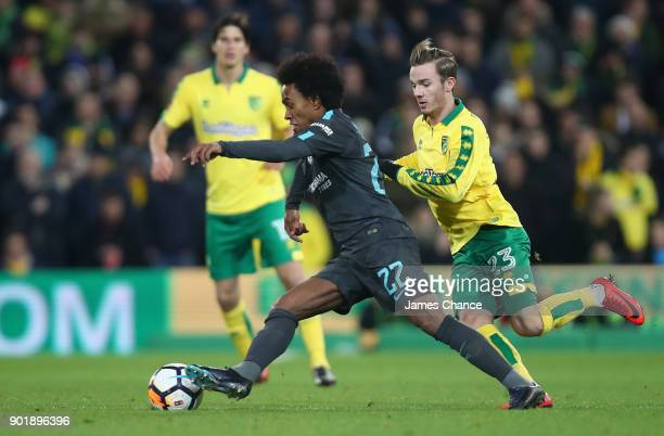 Willian of Chelsea is challenged by James Maddison of Norwich City during the The Emirates FA Cup Third Round match between Norwich City and Chelsea...