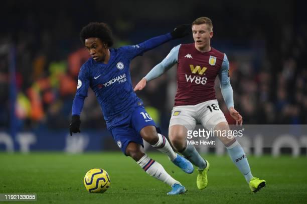 Willian of Chelsea is challenged by Matt Targett of Aston Villaduring the Premier League match between Chelsea FC and Aston Villa at Stamford Bridge...