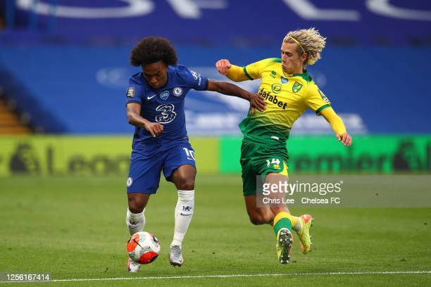 Willian of Chelsea is challenged by Todd Cantwell of Norwich City during the Premier League match between Chelsea FC and Norwich City at Stamford...