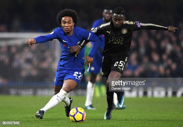 Willian of Chelsea is challenged by Wilfred Ndidi of Leicester City during the Premier League match between Chelsea and Leicester City at Stamford...