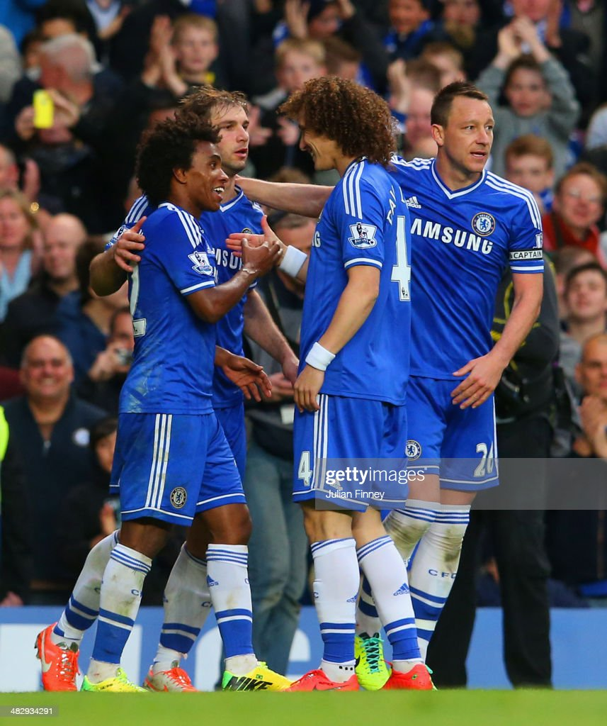 Willian of Chelsea is congratulated by Branislav Ivanovic, David Luiz and John Terry of Chelsea on scoring their third goal during the Barclays Premier League match between Chelsea and Stoke City at Stamford Bridge on April 5, 2014 in London, England.