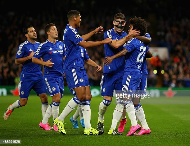 Willian of Chelsea is congratulated by Gary Cahill and Ruben Loftus-Cheek of Chelsea on scoring the opening goal during the UEFA Chanmpions League...