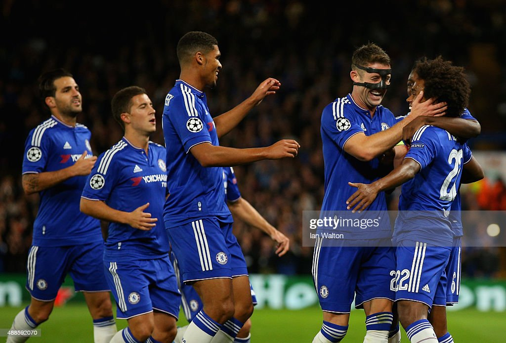 Willian of Chelsea is congratulated by Gary Cahill and Ruben Loftus-Cheek of Chelsea on scoring the opening goal during the UEFA Chanmpions League group G match between Chelsea and Maccabi Tel-Aviv FC at Stamford Bridge on September 16, 2015 in London, United Kingdom.